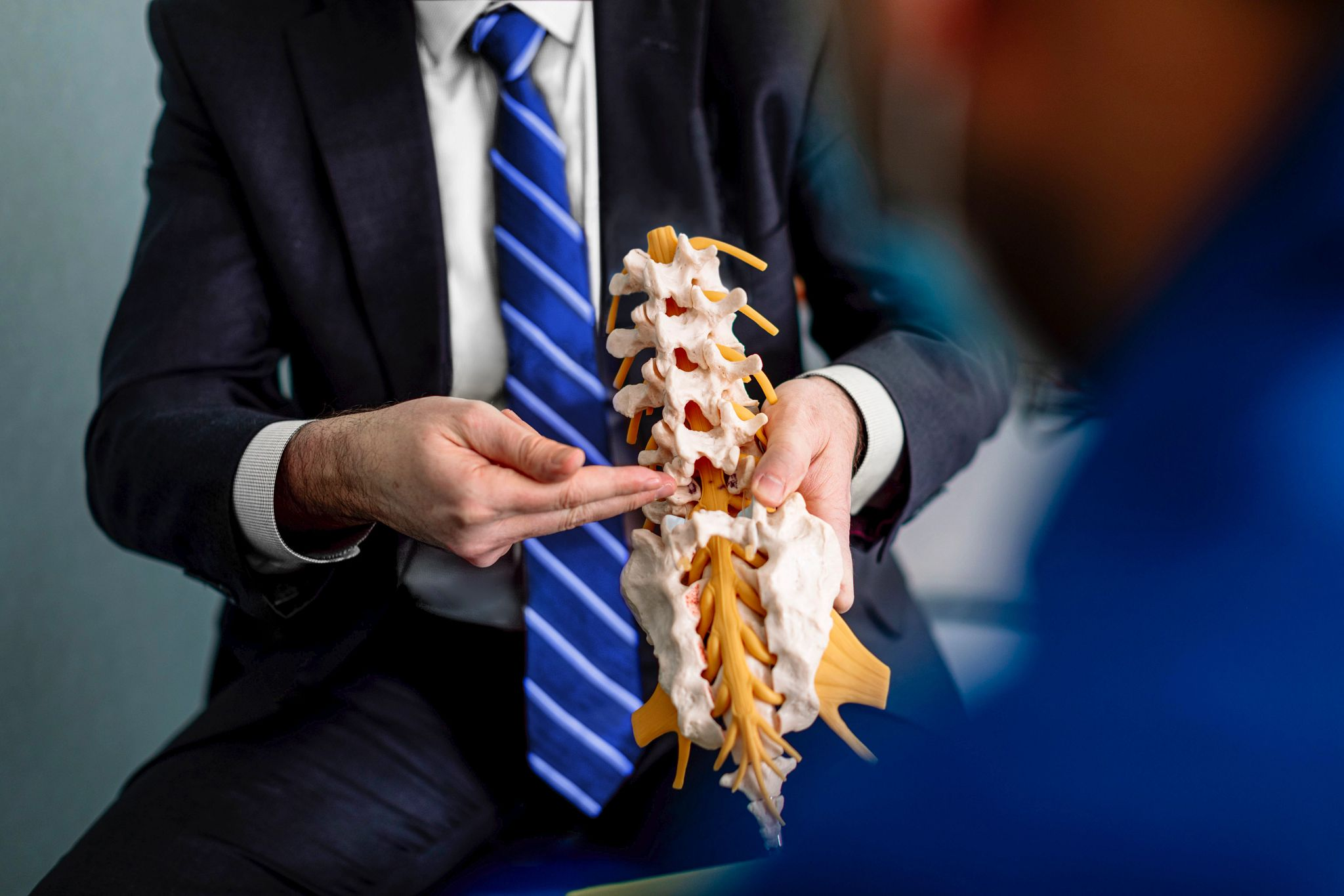 Reviewing a 3D Printed spine at a patient consult at Mayo Clinic.